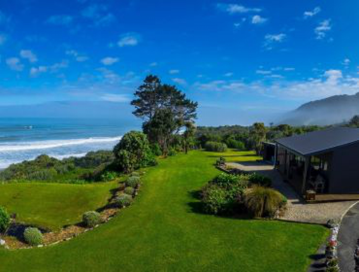 Photo of property: Breakers Boutique accommodation and views to Tasman Sea
